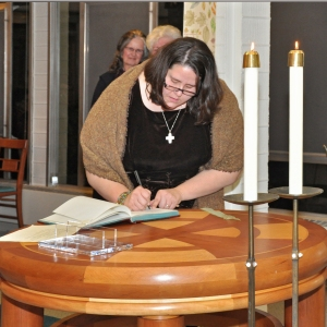 Signing my final profession of vows in our community vow book