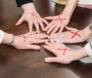 CSJP Leadership Team with red x's marked on their hands to show support for the End Slavery Intiative
