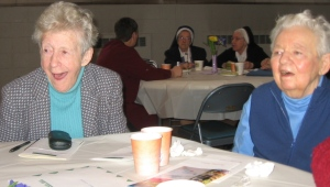 Jeanne (left) and Dorothy deeply engage at a community meeting in 2008